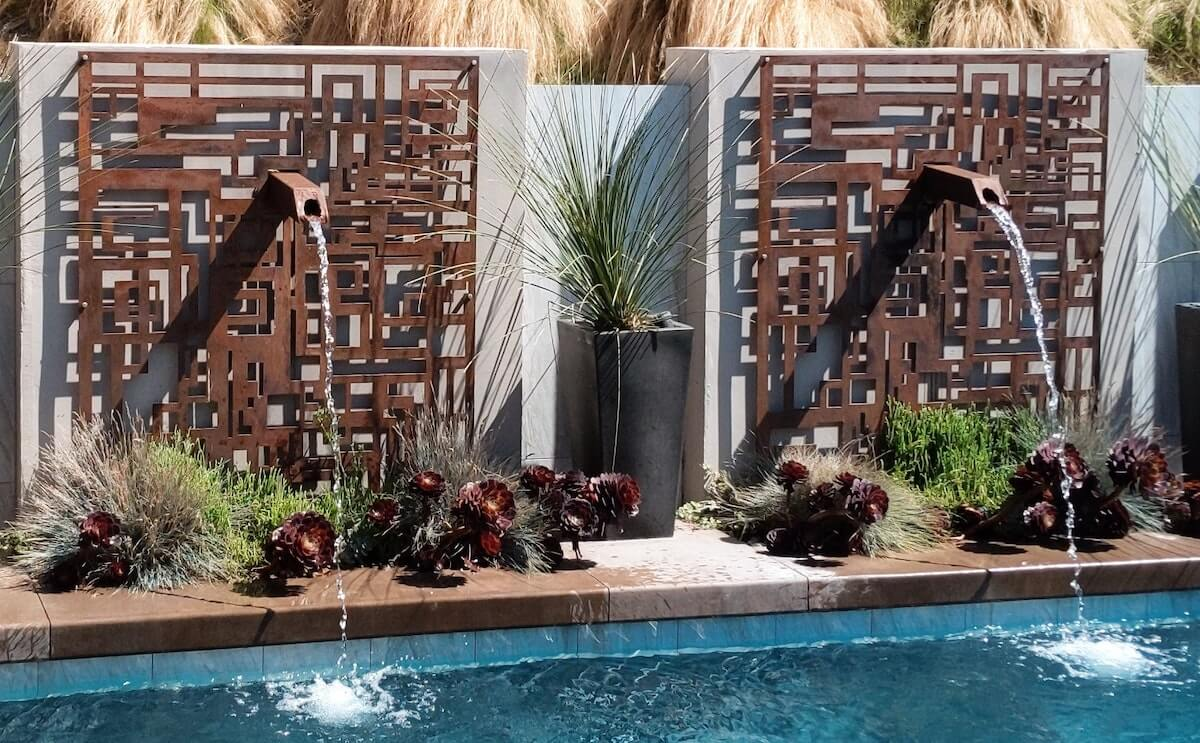 iron water fountain features at pool