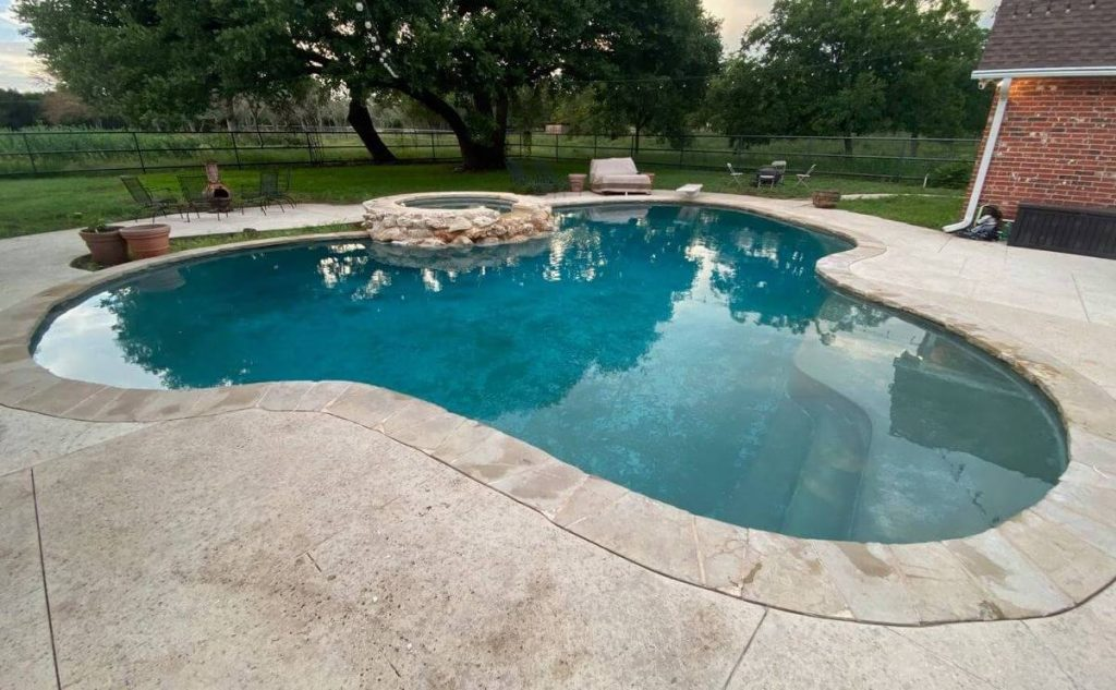 back yard pool cleaned by Covenant Pool Services