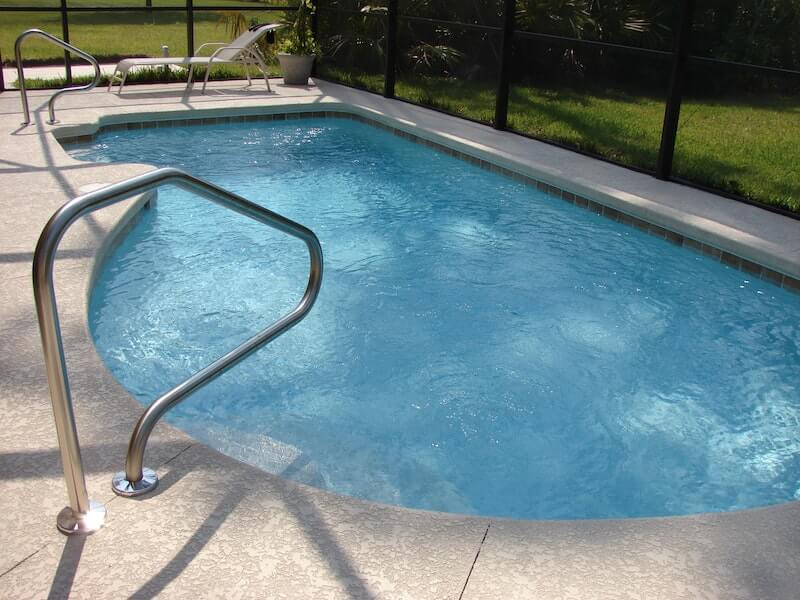 clean pool with ladder from weekly pool cleaning