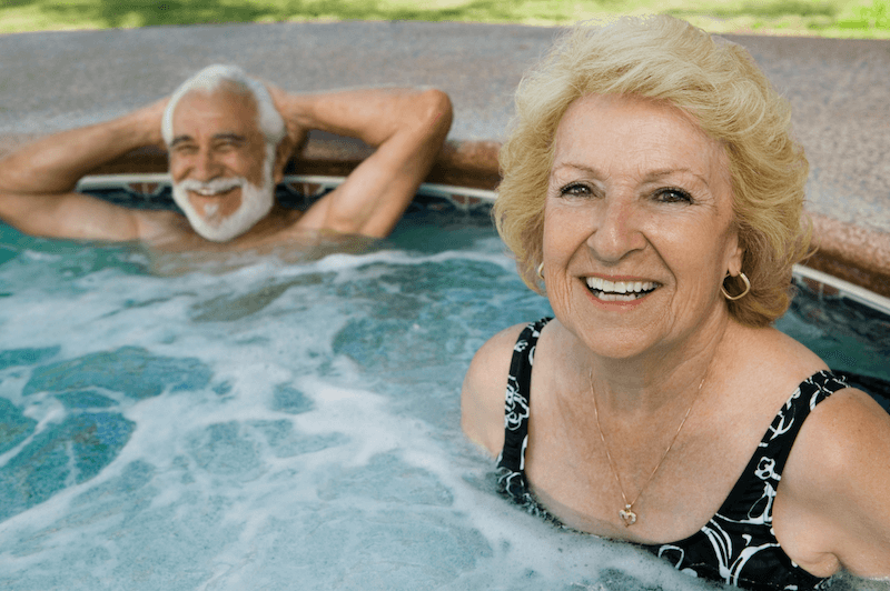 happy couple in soothing hot tub
